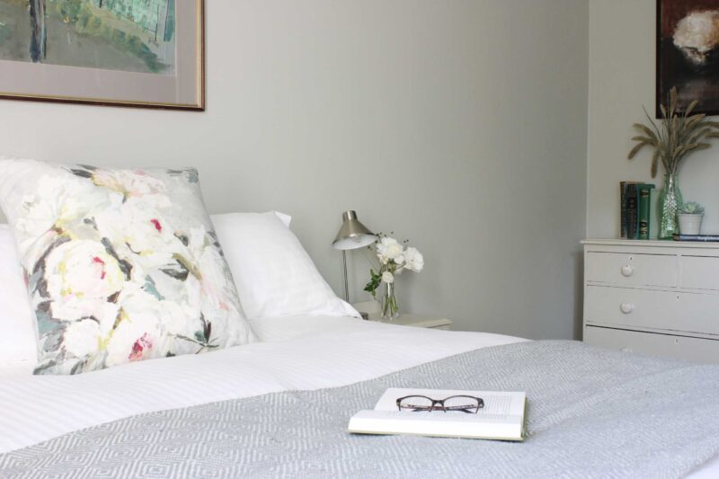 Bee bedroom focus on flowers to chest of drawers