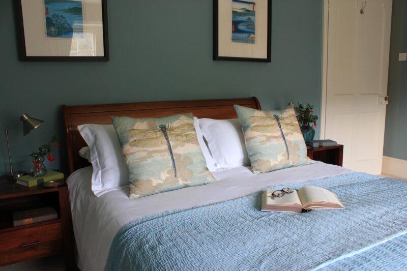 Cherry bedroom bed to door